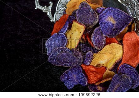 Potato Red Blue Chips Beet And Carrot Salty Chips In The Bag From The Wooden Background.