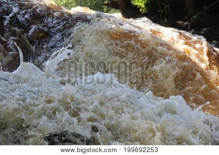 Close up of splashing water of the Lower Tahquamenon Falls in Upper Peninsula of Michigan.