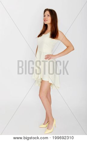 The portrait of beautiful woman in white dress.