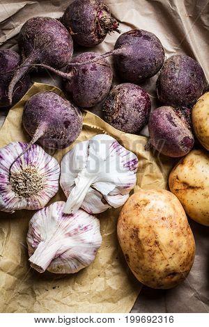 Close up of fresh organic potato, beetroot and garlic