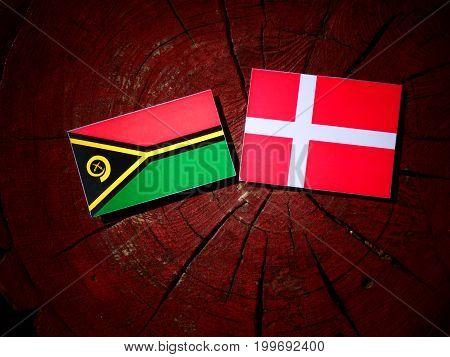 Vanuatu Flag With Danish Flag On A Tree Stump Isolated