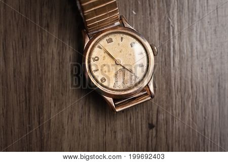 Vintage Wristwatch On A Wooden Table. Classic Watch