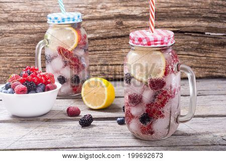 Ice cold summer drink lemonade with berries