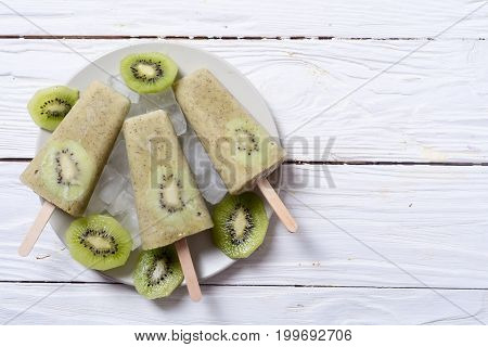 Homemade kiwi popsicle withe ice . Top view