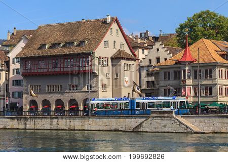 Zurich, Switzerland - 2 October, 2014: embankment of the Limmat river, old town buildings along it. Zurich is the largest city in Switzerland and the capital of the Swiss canton of Zurich.