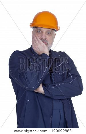 Surprised man with a beard in building overalls