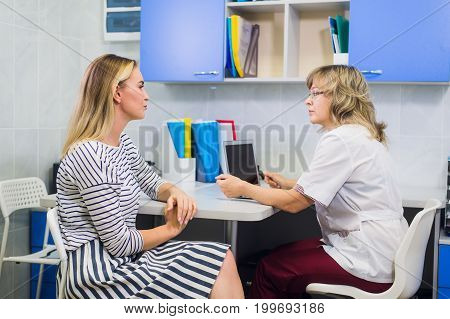 Female doctor gynecologist with patient at her office.