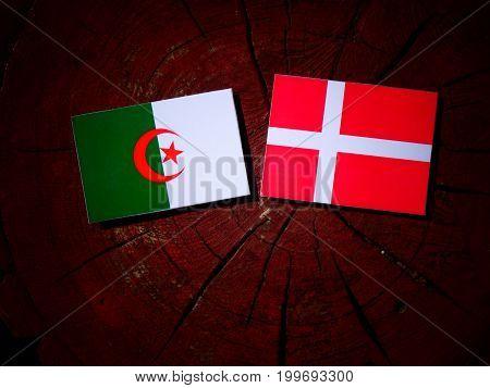 Algerian Flag With Danish Flag On A Tree Stump Isolated