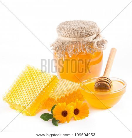 Jar with honey, honeycomb and bowl of honey on a white background