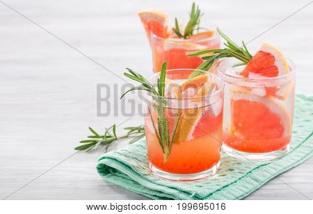 Summer cocktail with grapefruit and rosemary. Copy space
