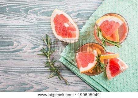 Summer cocktail with grapefruit and rosemary. view from above
