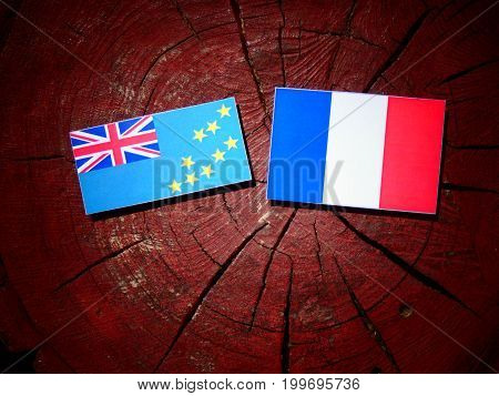 Tuvalu Flag With French Flag On A Tree Stump Isolated