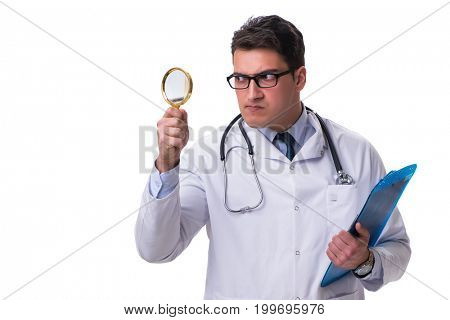 Young male doctor with a looking magnifying glass isolated on wh