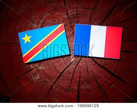 Democratic Republic Of The Congo Flag With French Flag On A Tree Stump Isolated
