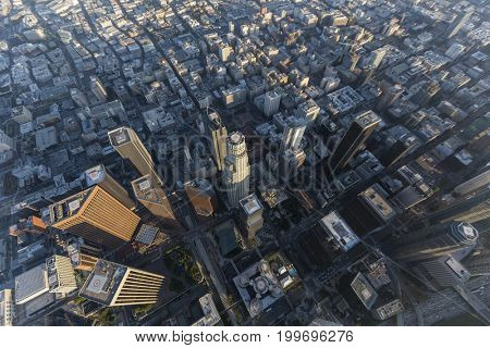 Hazy afternoon aerial view of Bunker Hill towers in urban downtown Los Angeles, California.