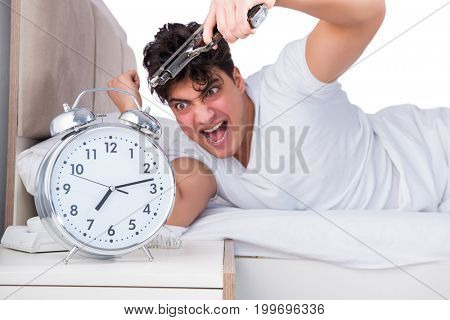 Man in bed suffering from insomnia