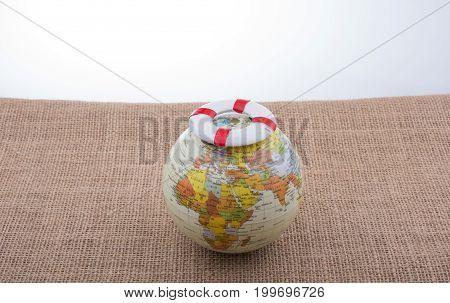 Life Preserver On Top Of Globe