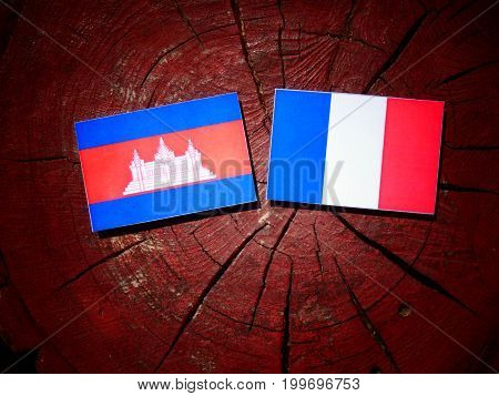 Cambodian Flag With French Flag On A Tree Stump Isolated