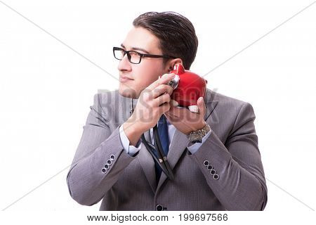 Businessman with stethoscope and piggybank isolated white backgr