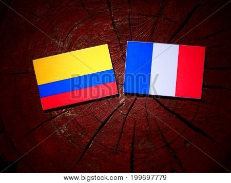 Colombian Flag With French Flag On A Tree Stump Isolated