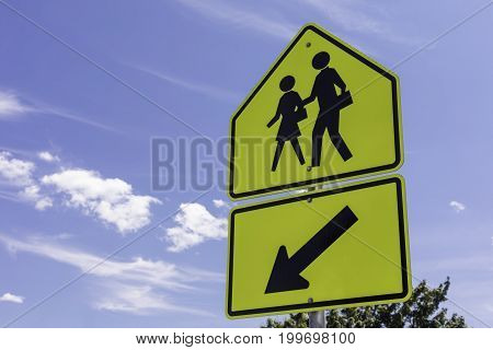 school zone sign in front of a blue sky