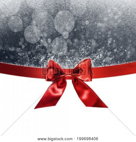 Red gift ribbon bow and bokeh lights isolated on white background