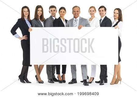 Group of business people holding white blank banner isolated on white background
