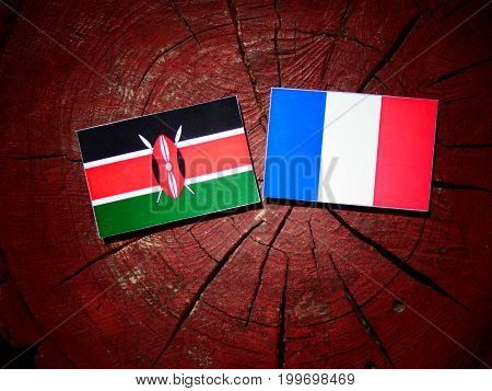 Kenyan Flag With French Flag On A Tree Stump Isolated