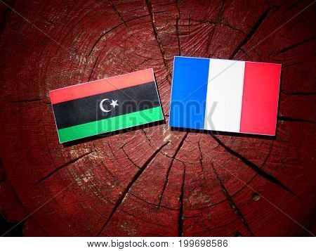 Libyan Flag With French Flag On A Tree Stump Isolated