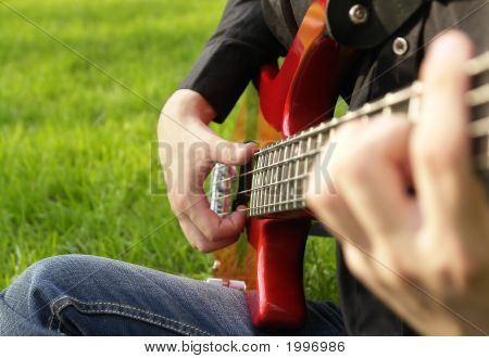 Teenage Boy Playing The Bass Guitar