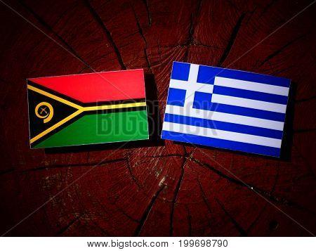 Vanuatu Flag With Greek Flag On A Tree Stump Isolated
