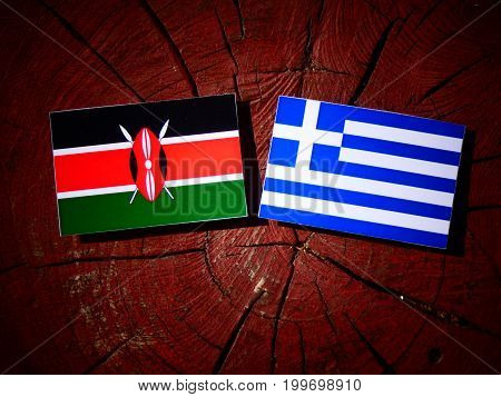 Kenyan Flag With Greek Flag On A Tree Stump Isolated