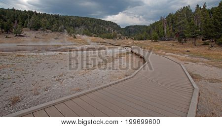 Elevated boardwalk / walkway leading to Firehole Lake in the Lower Geyser Basin in Yellowstone National Park in Wyoming United States