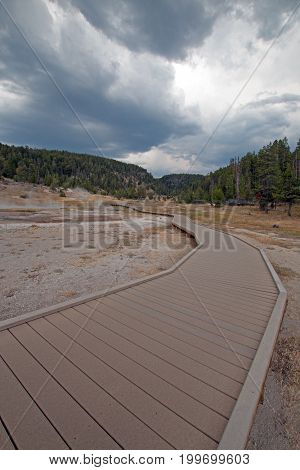 Boardwalk / walkway leading to Firehole Lake in the Lower Geyser Basin in Yellowstone National Park in Wyoming United States