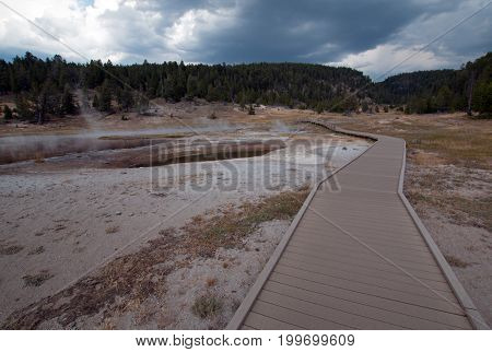 Elevated walkway leading to Firehole Lake in the Lower Geyser Basin in Yellowstone National Park in Wyoming United States