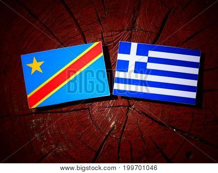 Democratic Republic Of The Congo Flag With Greek Flag On A Tree Stump Isolated