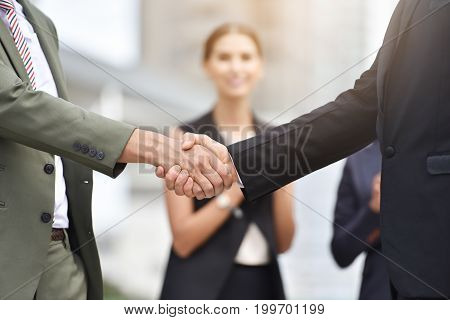 Happy business people handshaking after negotiation with businesswoman clap their hands background.