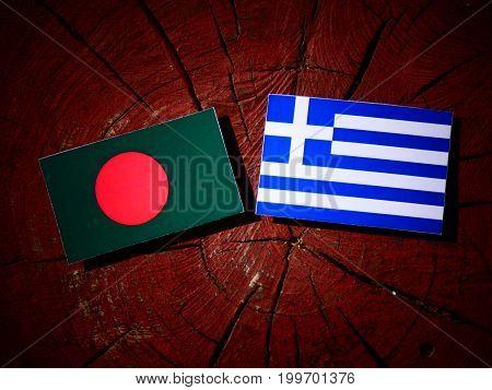 Bangladesh Flag With Greek Flag On A Tree Stump Isolated