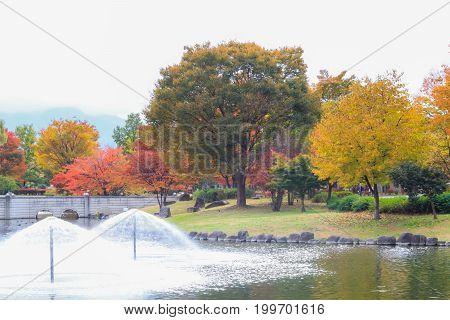 Japan autumn Fountain in in soft focus and blur style Obuse park NaganoJapan.
