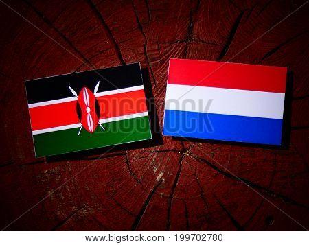 Kenyan Flag With Dutch Flag On A Tree Stump Isolated