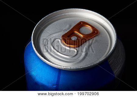 Metal beer can close-up isolated on black background