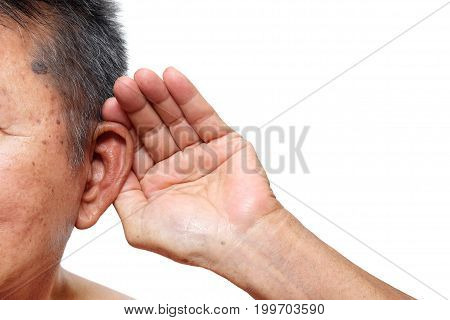 Old man paying attention to listening sound Age-related hearing loss problem in elderly.