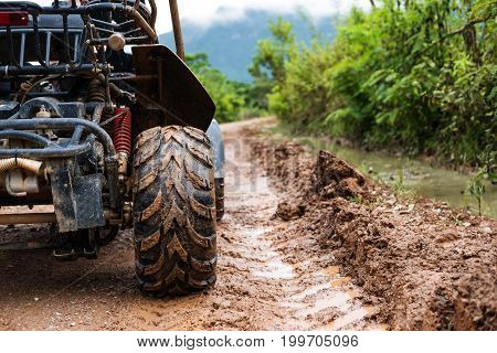 Traveling activity, Off road buggy on country road in rainy day