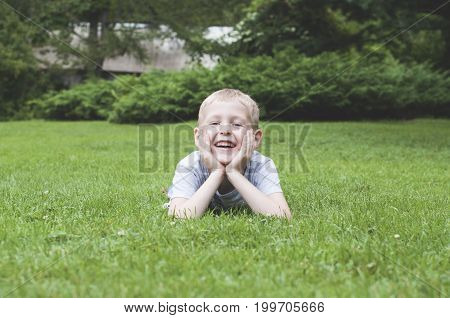 Laughing Kid On A Green Grass