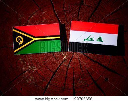 Vanuatu Flag With Iraqi Flag On A Tree Stump Isolated