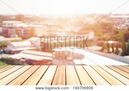 Bridge deck wood plane blur city background.