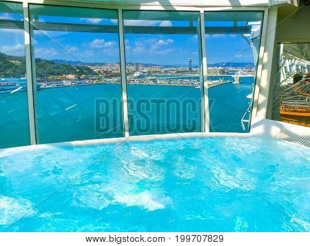 Barcelona, Spain - September 06, 2015: The Swimming pool Jacuzzi at cruise ship Allure of the Seas, The Royal Caribbean International. The view of the upper deck of ship