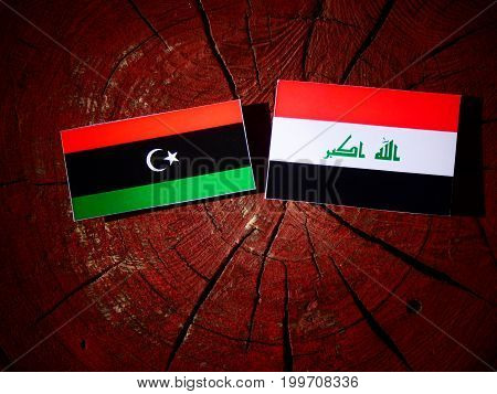 Libyan Flag With Iraqi Flag On A Tree Stump Isolated