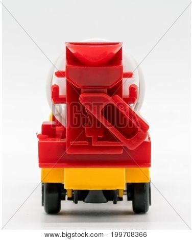 Yellow Cement Mixer Truck Toy Isolated On White