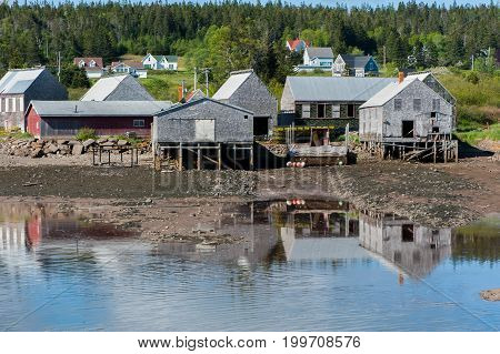 Fishermen's Sheds In The Cove